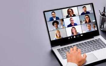 Laptop screen showing nine people